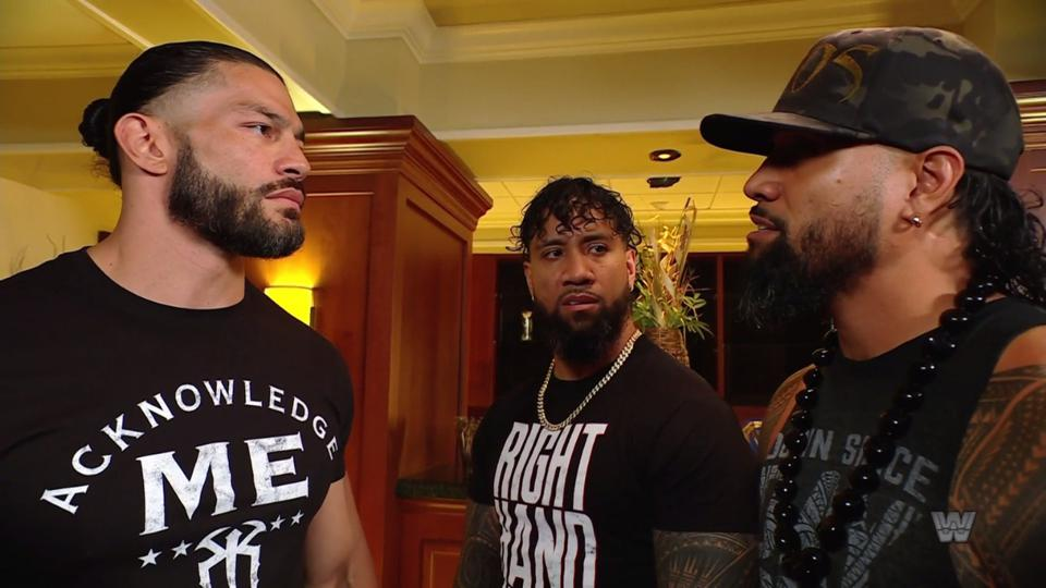 Roman Reigns and Jimmy Uso face off backstage.