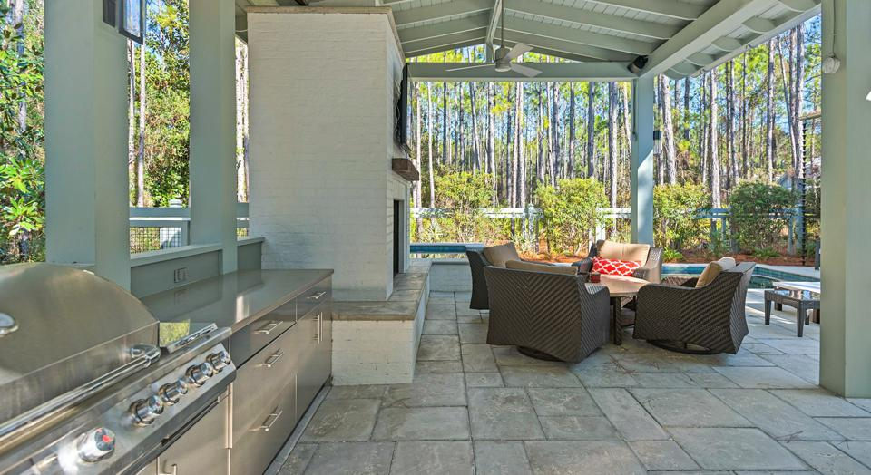 An outdoor grill set and patio table.