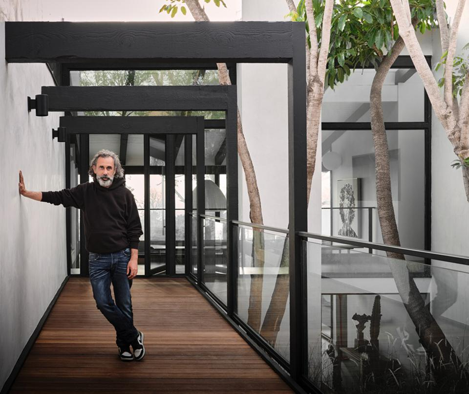 Philippe Naouri standing in front of edward fickett-designed midcentury house