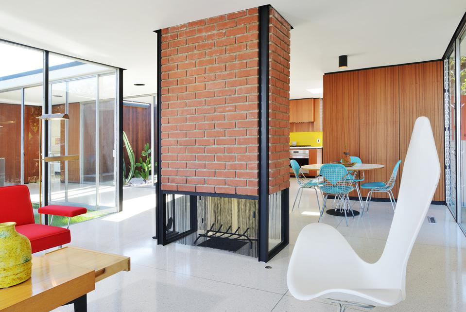 brick fireplace inside restored kuderna house hollywood hills craig ellwood