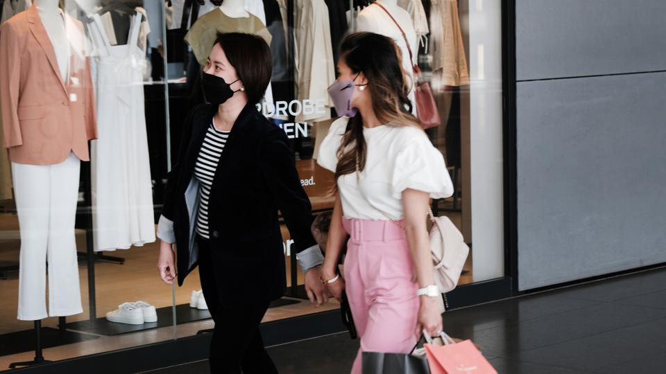 Shoppers wearing face masks inside of a shopping mall in Manhattan on May 13, 2021 in New York City.