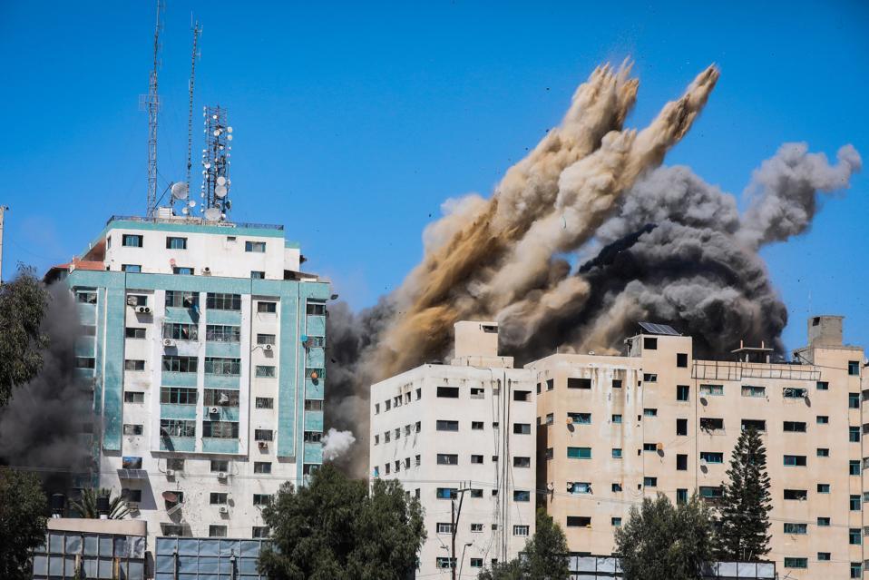Israeli airstrike destroys a high-rise building in Gaza