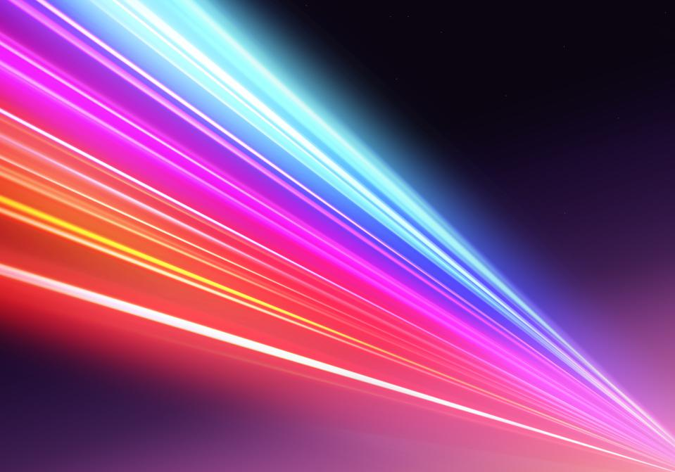 Abstract picture of colorful light trails crossing twilight sky with fast motion.