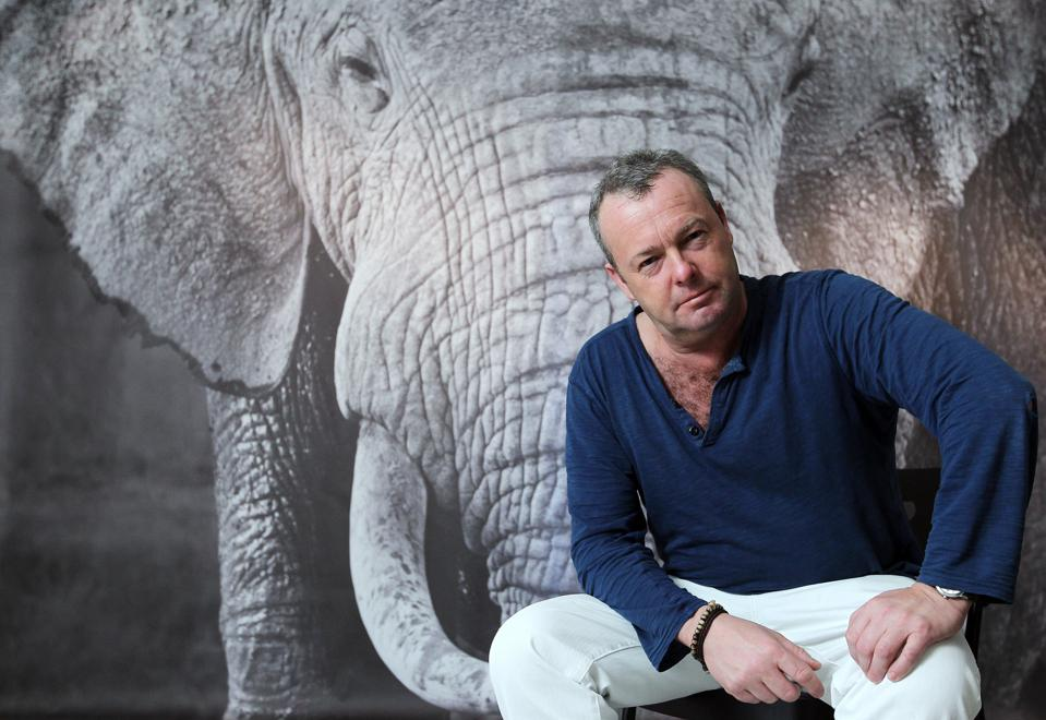 David Yarrow poses for picture in his exhibition at The Space Gallery in Sheung Wan. 22NOV13