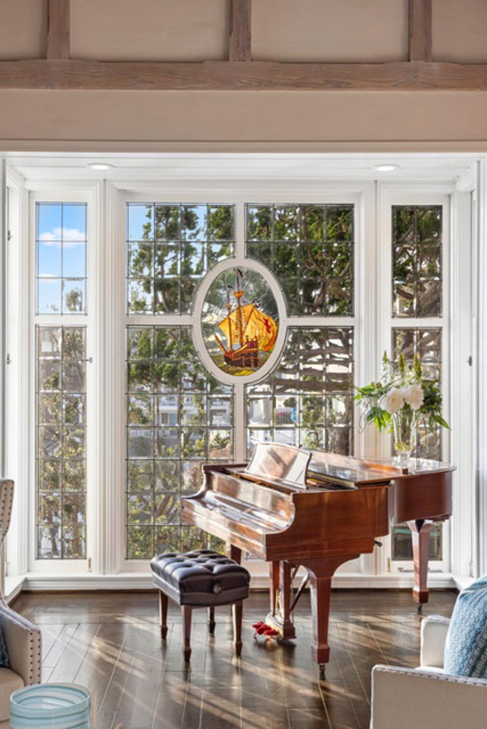 Piano and stained glass window.