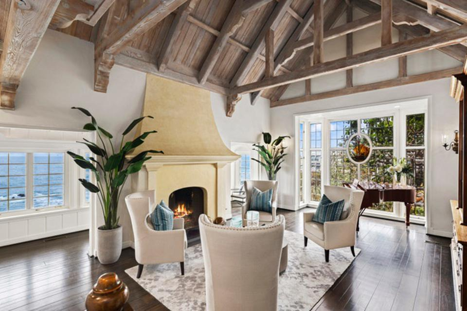Great room with a vaulted wood ceiling and limestone fireplace.