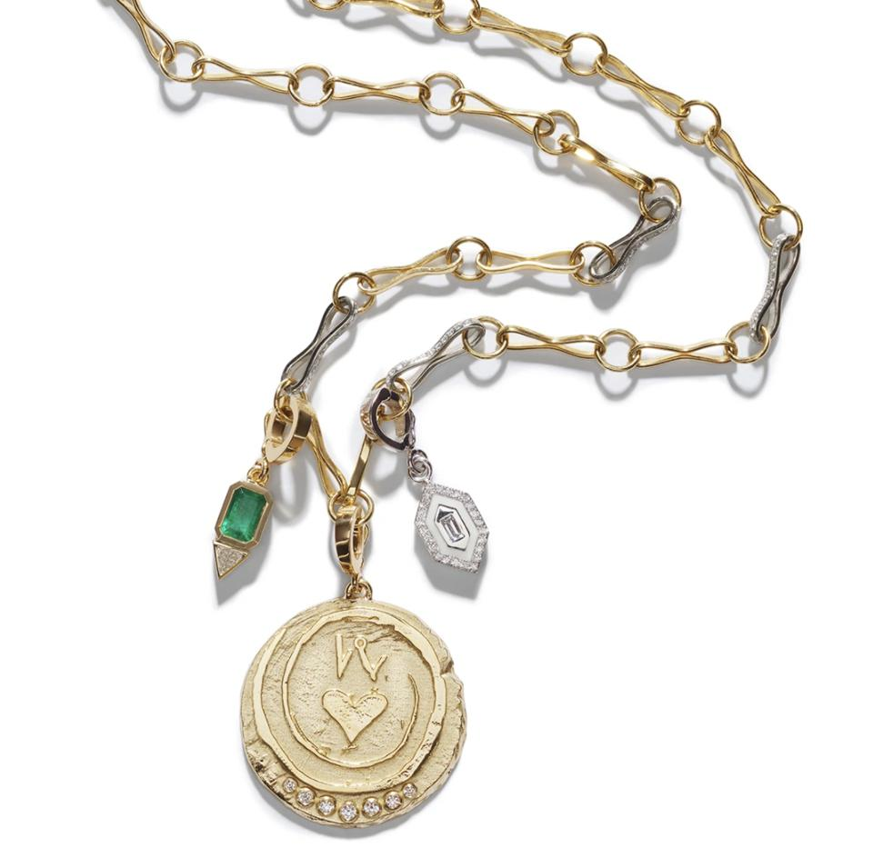 a necklace with a coin charm