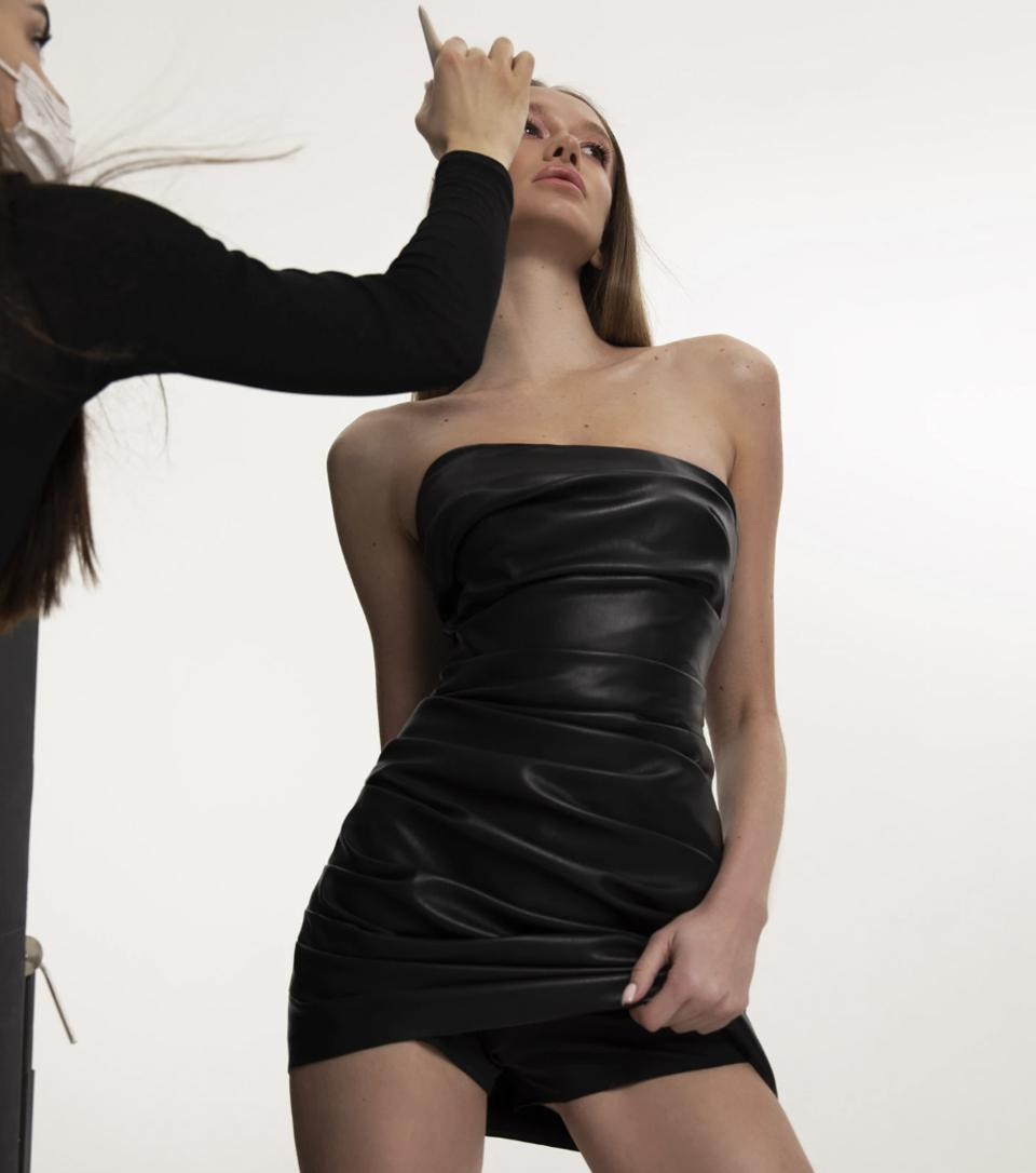 a model wearing a little black dress