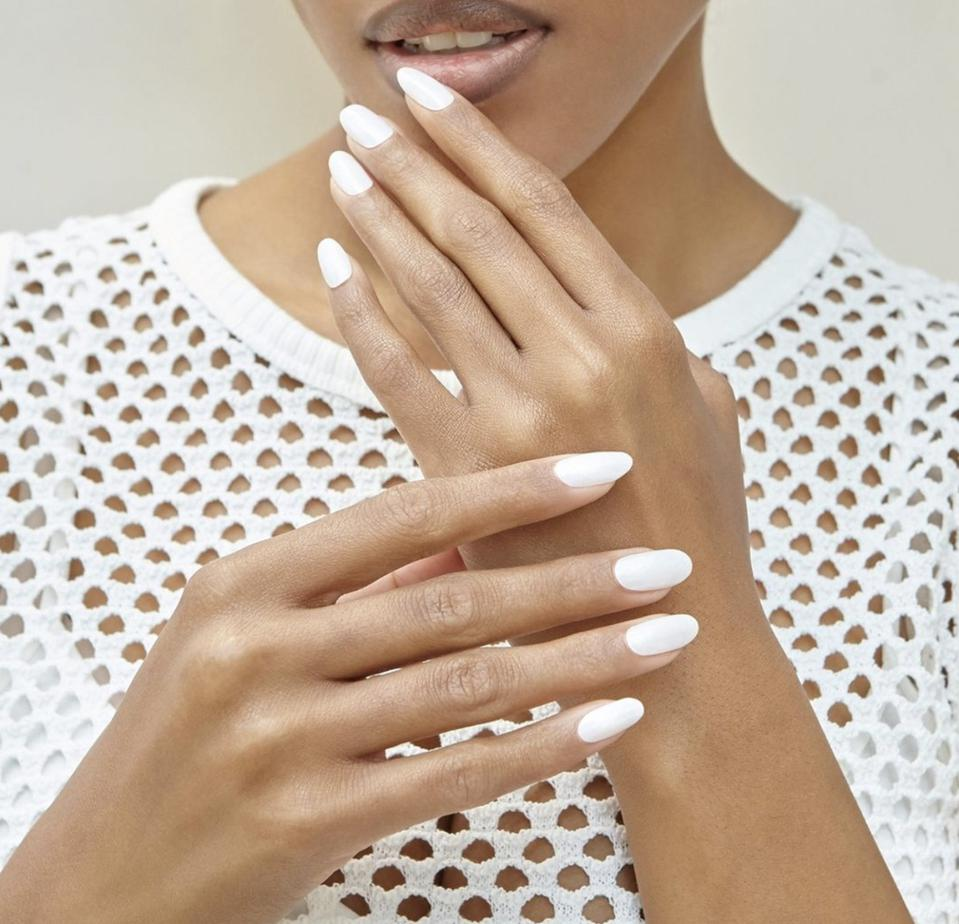 model with white gel nails