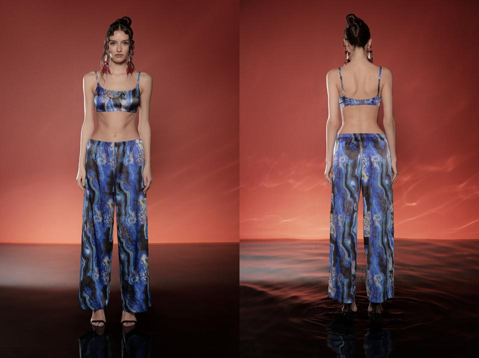 a woman in blue matching bralet and pants