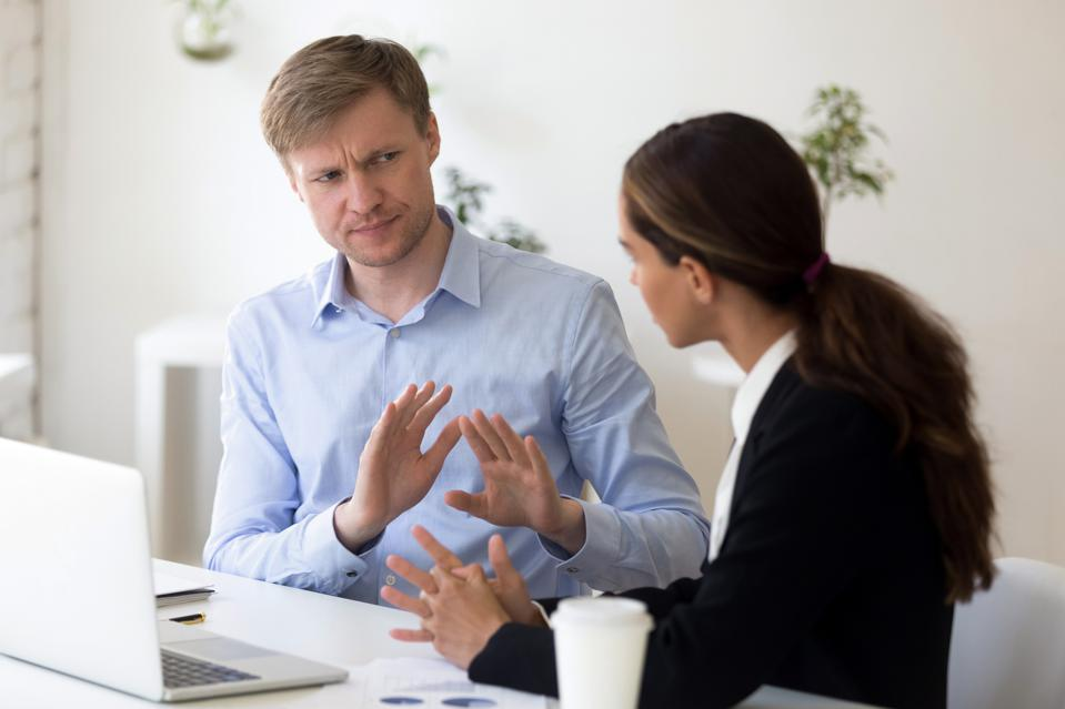 Millennial businessman rejecting giving interview to journalist