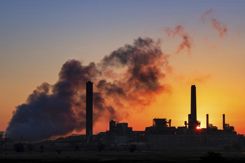 Smoke billows from the Dave Johnston coal-fired power plant in Wyoming at sunrise.