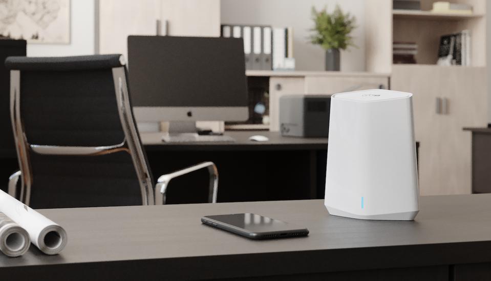 Netgear Orbi Pro Mini on a desk
