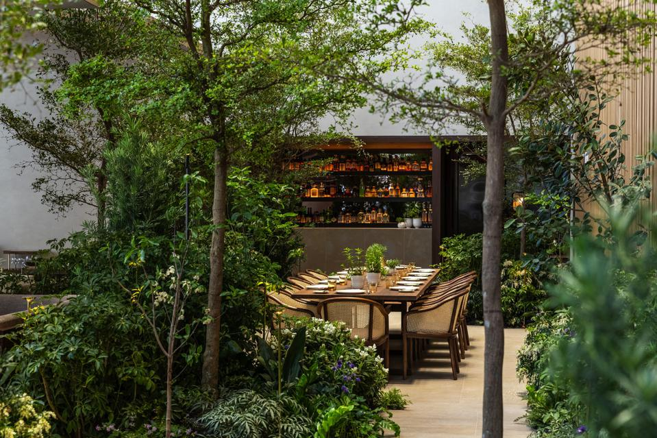 At Le Pavillon, a long communal table can be reserved at the center of the interior garden.