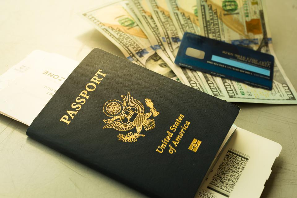 USA passport and boarding pass, with payment of cash and credit card at the airport.