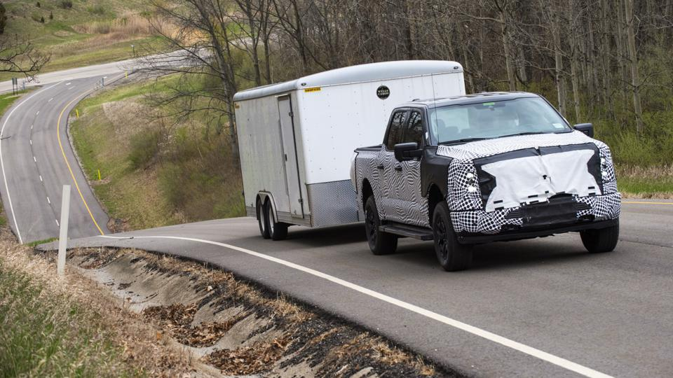 2023 Ford F-150 Lightning electric pickup towing a 6,000-lb trailer up a 25% grade