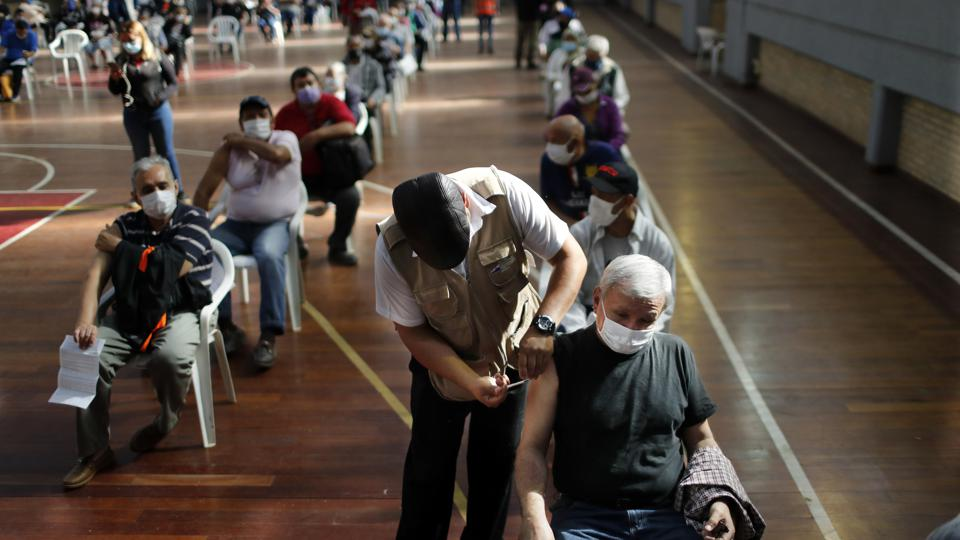 People over age 65 get shots of the AstraZeneca vaccine for COVID-19 in San Lorenzo, Paraguay