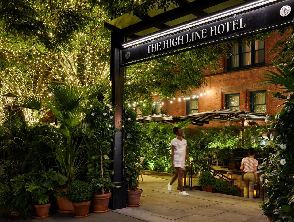 The front garden of the High Line Hotel in New York has become a lively outdoor bar.