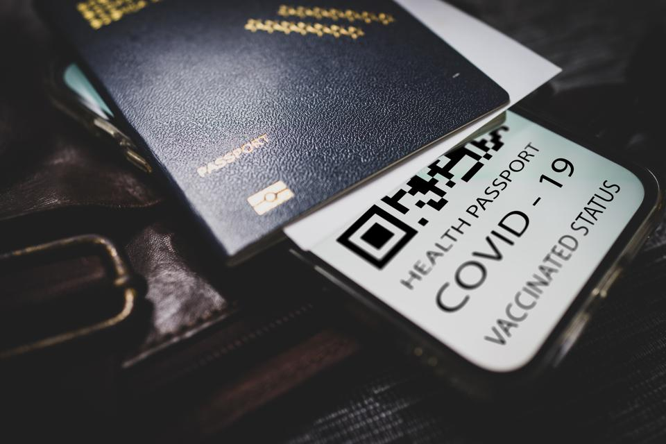 Covid-19 passport with QR code on smartphone