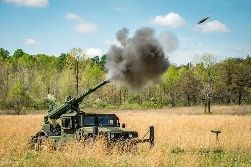 A 105mm Howitzer seen here on a soft recoil-equipped HUMVEE.