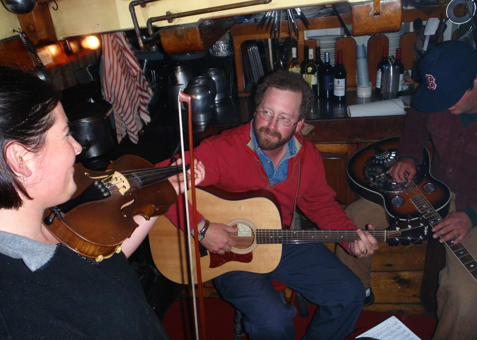 Stephen Taber's captain Noah entertains guests on board on his guitar