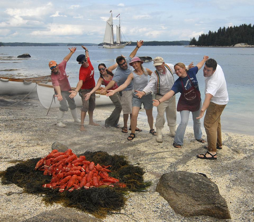 A lobster casserole ashore with 8 smiling passengers posign for the camera