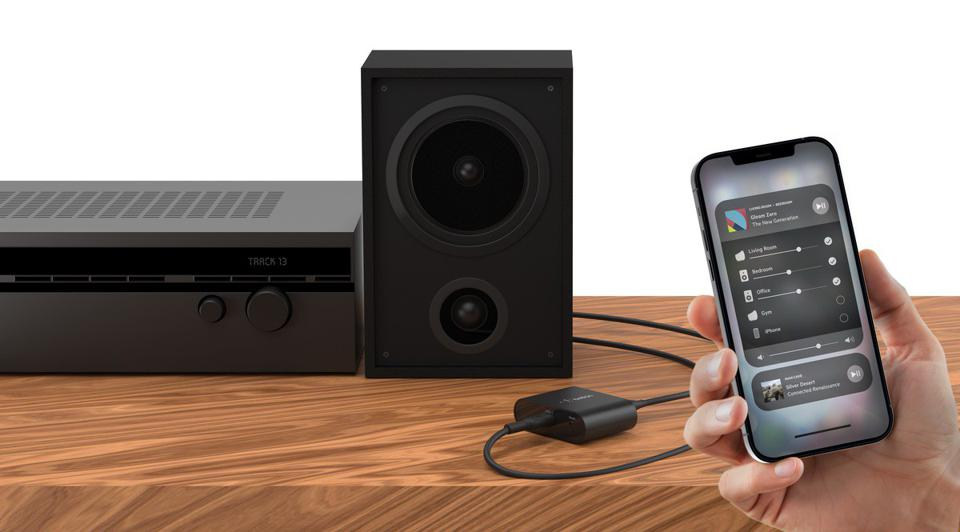 Audio system and a hand holding an iPhone