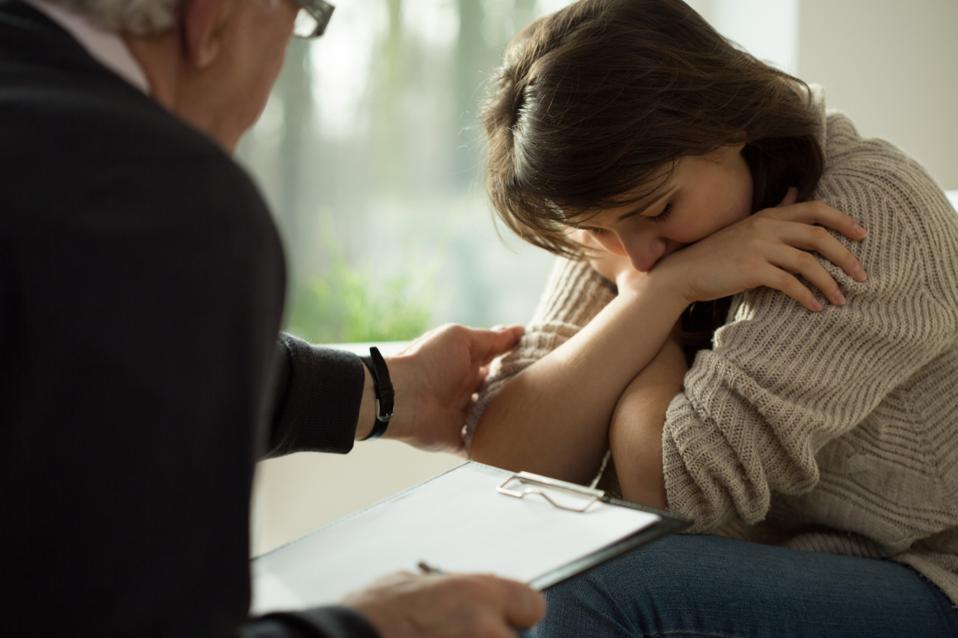 Psychologist comforting his patient