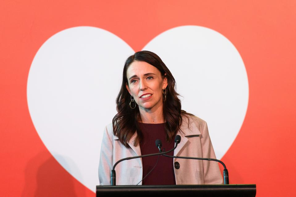 Jacinda Ardern in front of a white heart shaped graphic