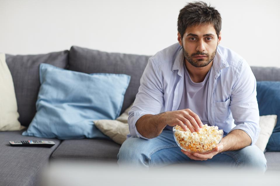Adult Man Watching TV at Home