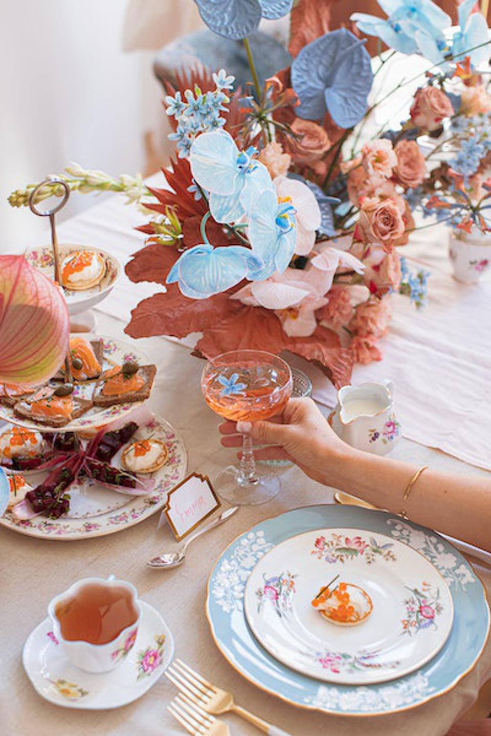 A tablescape with flowers and upcycled china