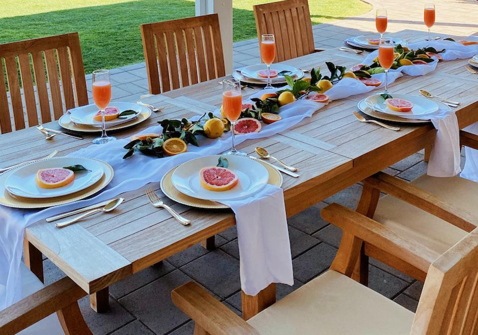 A citrus themed tablescape on a wood table