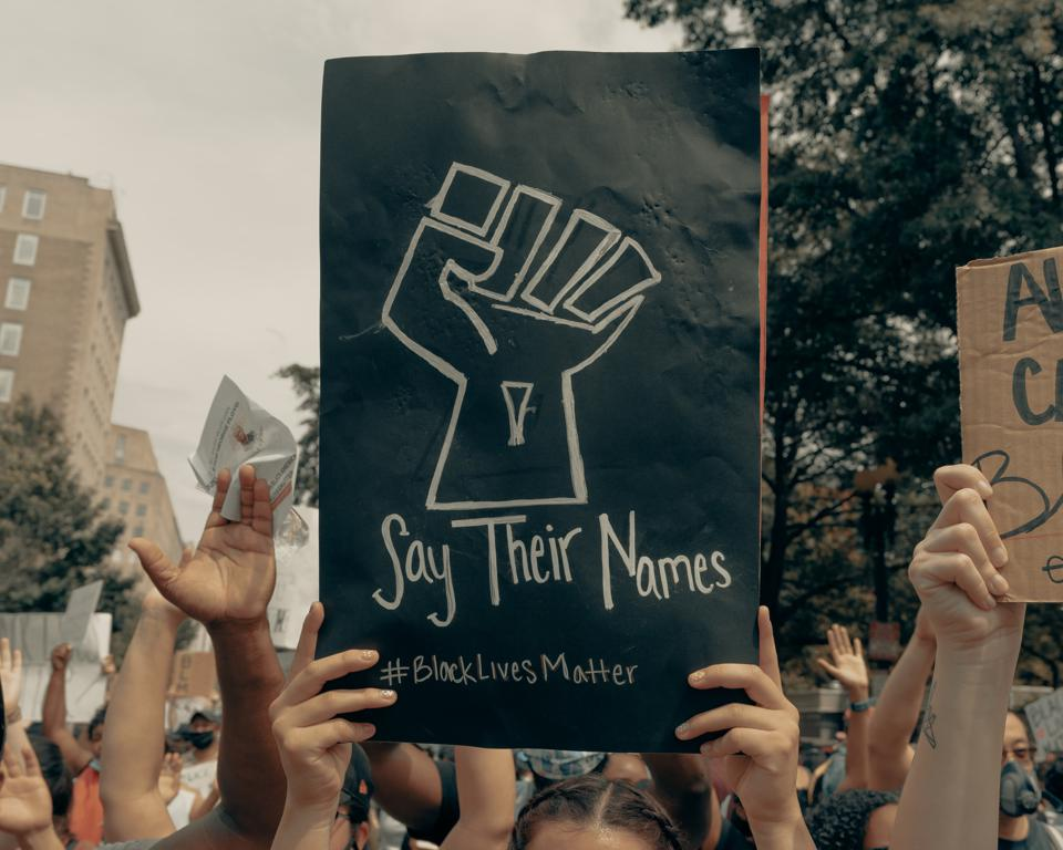 Woman holds up a sign at the Black Lives Matter protest in Washington DC 6/6/2020