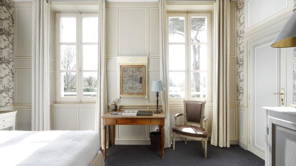 The rooms at Chateau La Chenevière look out over the gardens.