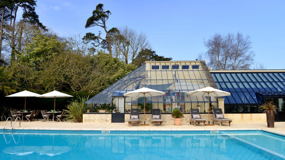 The outdoor pool and restaurant at Chateau La Chenevière in Lower Normandy, France.