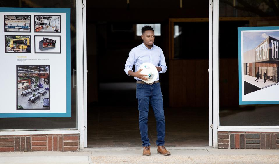 man at door entrance of a new building