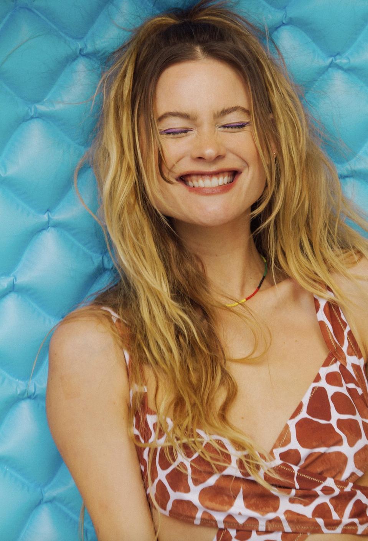 model in swimwear with blue background