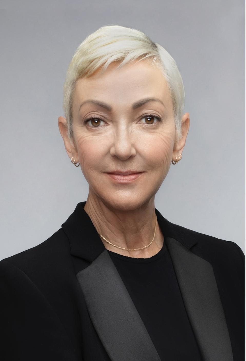 a headshot of a business woman