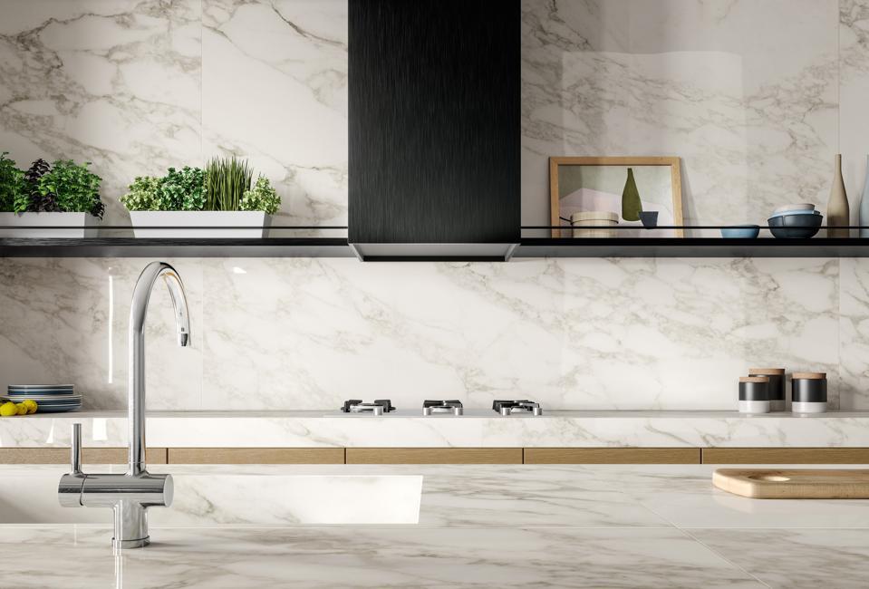 Modern kitchen with porcelain slab tops and splash.