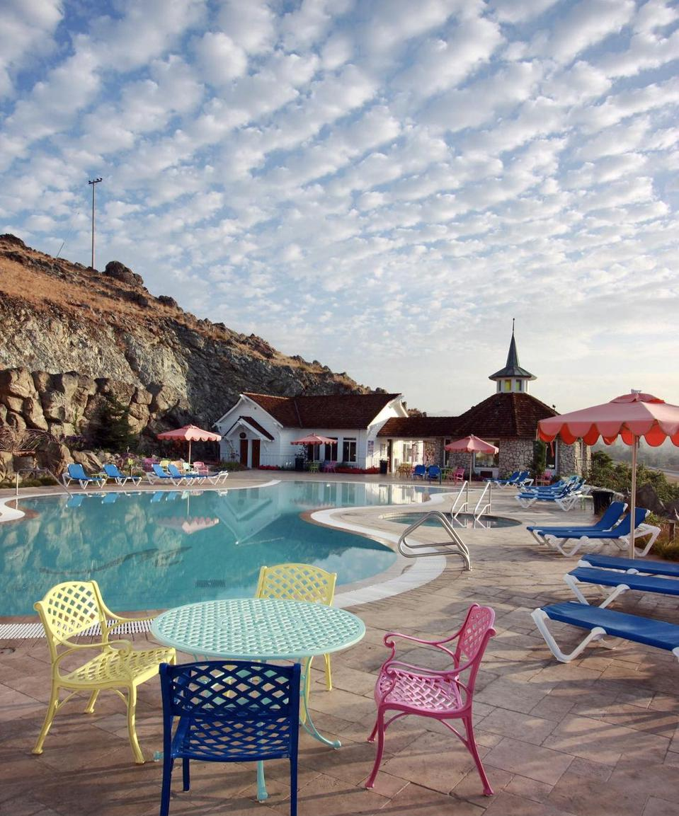 The Madonna Inn features an infinity pool on a rocky hillside.