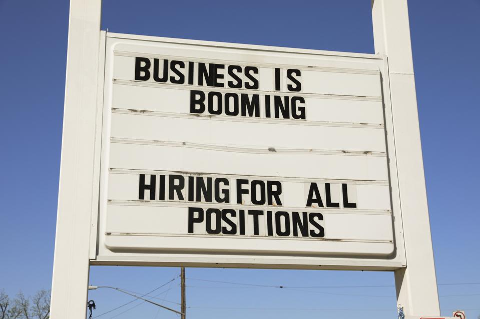 Business is booming exterior sign
