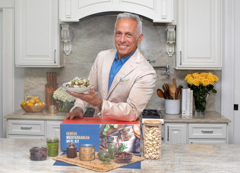chef Geoff zakarian holds a plate of tuna pasta with pesto and herbs from Genova tuna