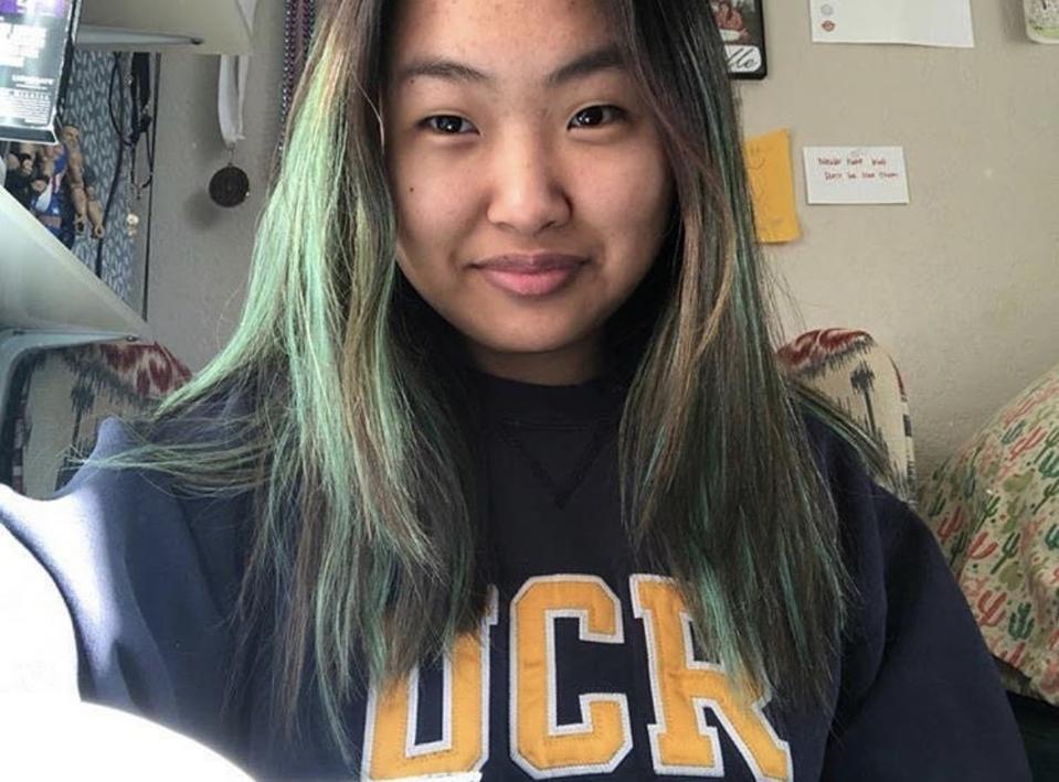 Michelle wearing a University of Riverside sweatshirt