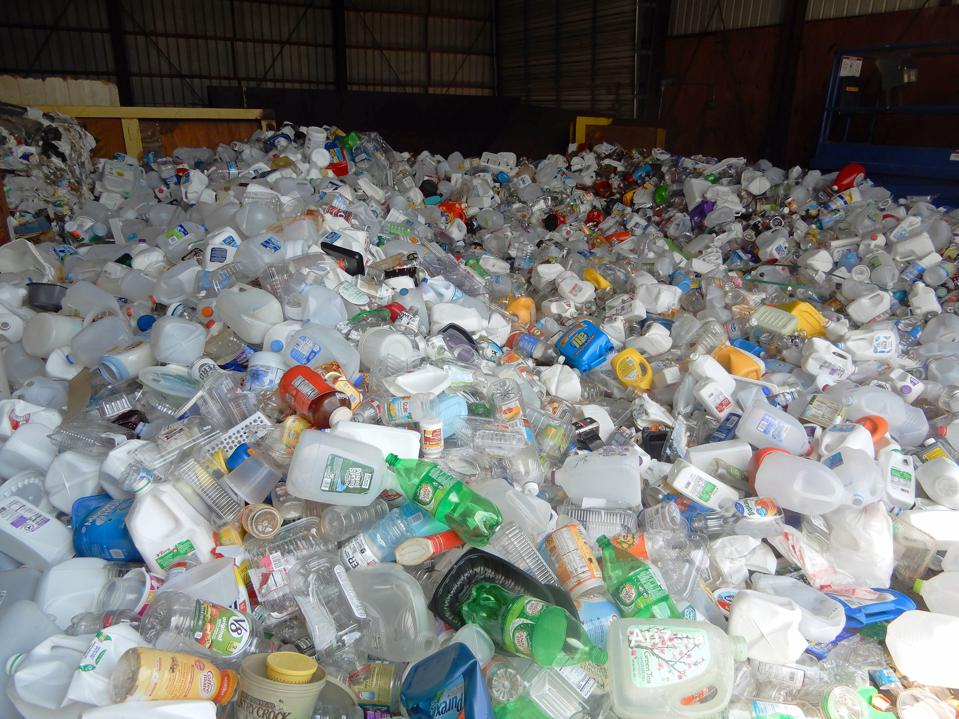 Plastic Containers Piled up at Recycling Center, Wellsville, New York
