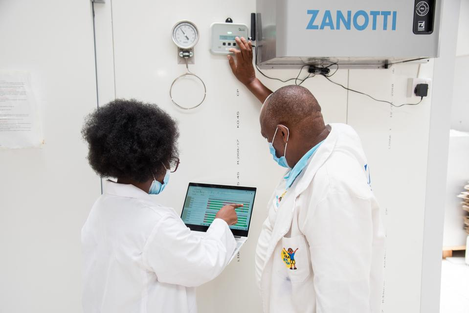 A Nexleaf team member and a Cold Chain Engineer from Kenya's Ministry of Health analyze data generated from Nexleaf's sensors