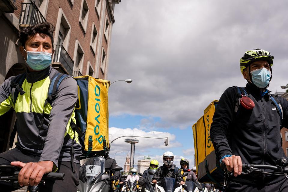 Glovo distributors seen in front of Puerta de Moncloa during...