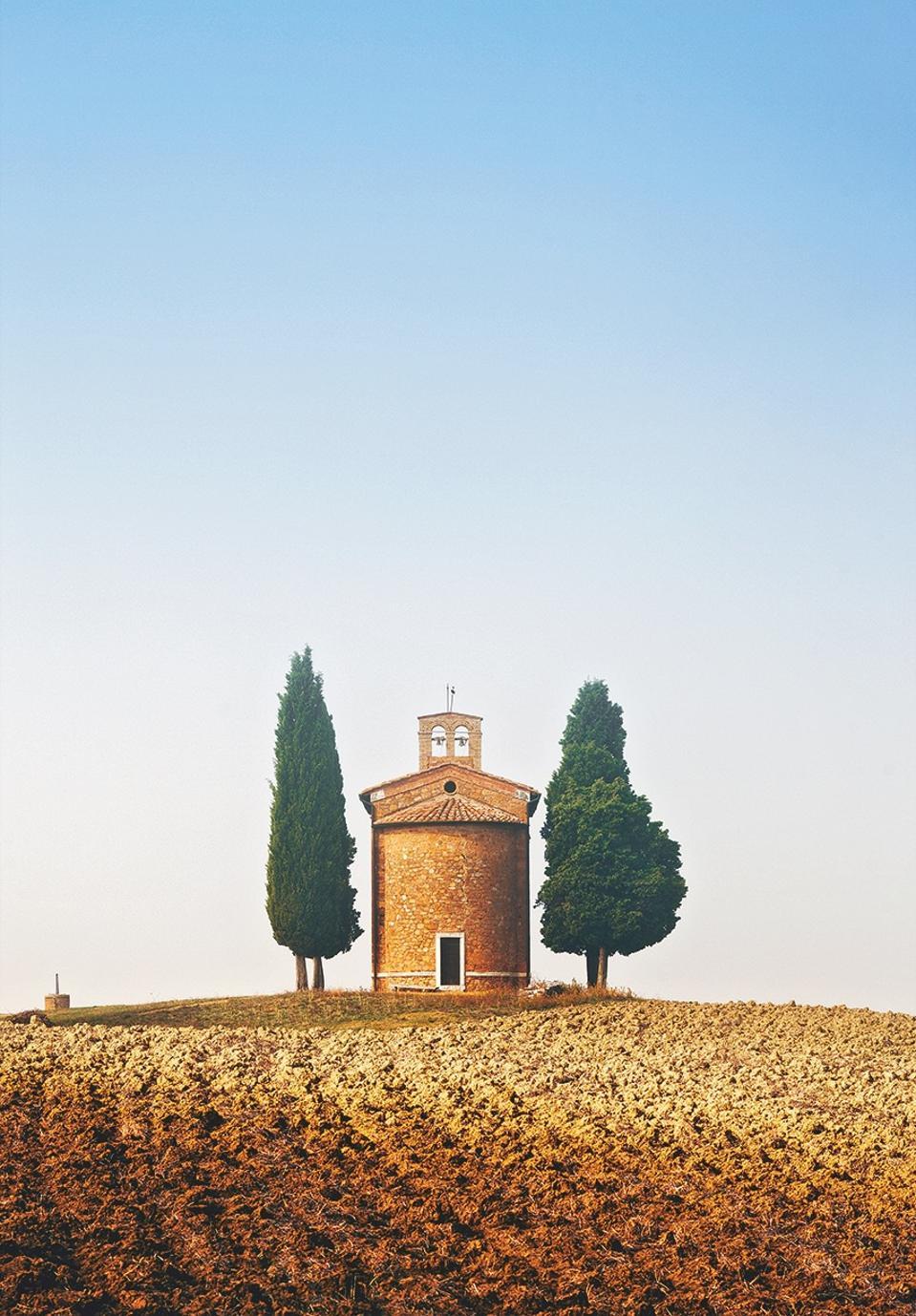 Church in the mist on the hillside