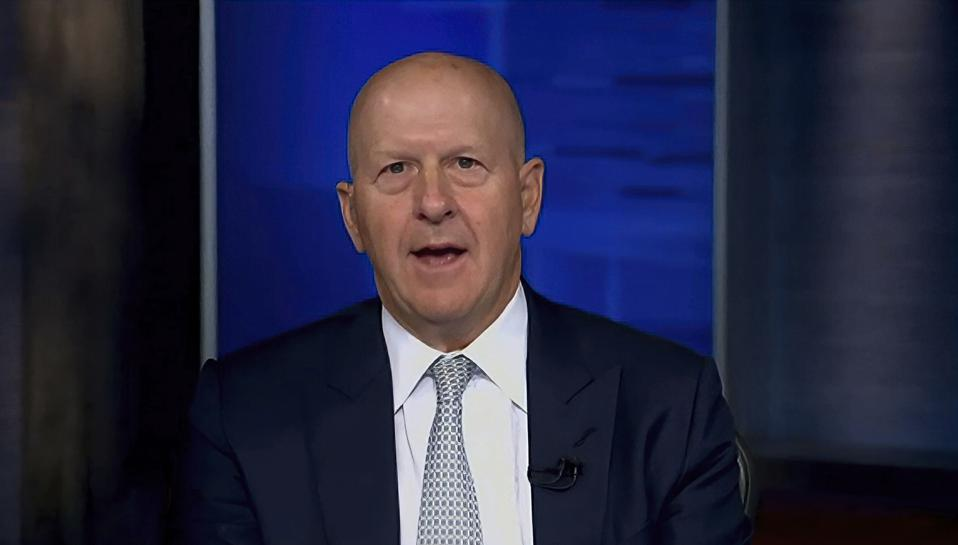 David Solomon in front of a blue screen