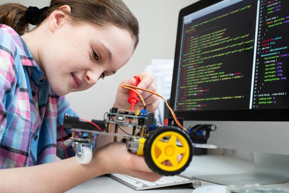 Female Pupil Building Robotic Car In Science Lesson