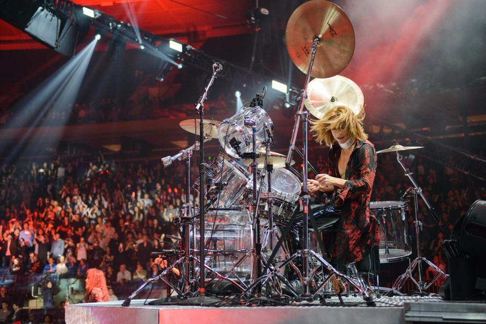 Yoshiki performs live on stage in Madison Square Garden.